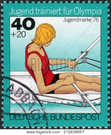 GERMANY - CIRCA 1976: Postage stamp printed in Germany Issue: Youth training for the Olympics depicts Rowing single sculls circa 1976