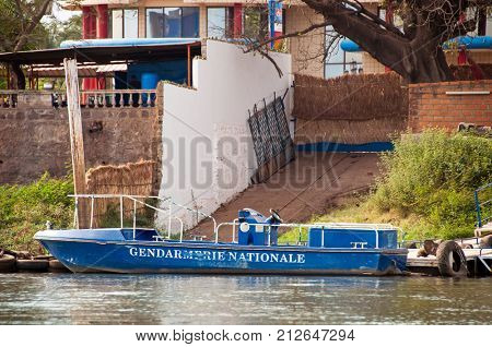 BAMAKO, MALI - CIRCA FEBRUARY 2012: Gendarmerie Nationale boat on the river Niger in Bamako