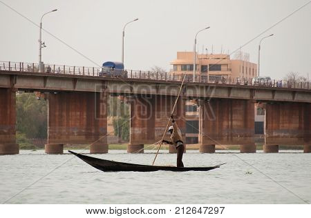 BAMAKO, MALI - CIRCA FEBRUARY 2012: Bozo fisherman on the river Niger in Bamako.