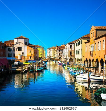 Chioggia town in venetian lagoon water canal and church. Veneto Italy Europe