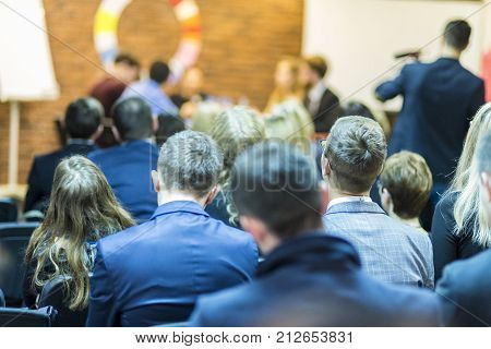 Mediation at The Round Table.Group of Professional Mediators Presenting at the Round Table on Stage Before the Audience. Horizontal Image Orientation