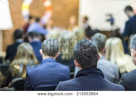 Mediation at The Round Table.Group of Professional Mediators Presenting at the Round Table on Stage Before the Audience. Horizontal Image