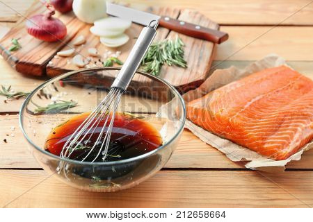 Soy marinade for salmon and fillet on wooden table