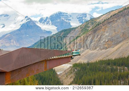 Athabasca Skywalk August 2015 In this no snow period tourists come at Athabasca to visit this exciting cliff-edge walkway because it leads to a platform where glass is all that separates them from a big foot drop and the scenary of the Athabasca glascier