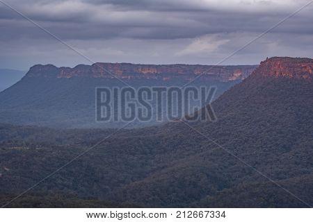 An escarpment in the Australian bush at sunset
