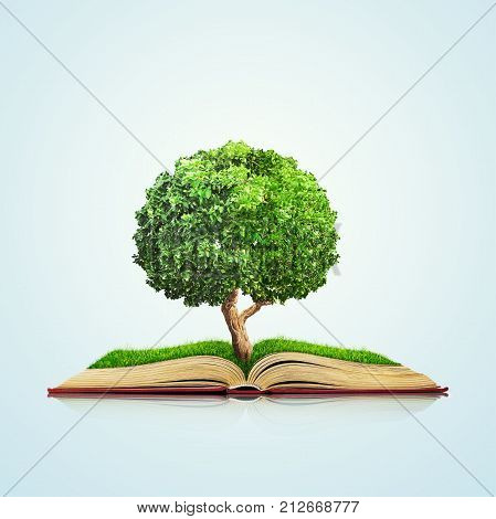3d illustration of Open book with green grass field and tree on it isolated over blue background. Concept image