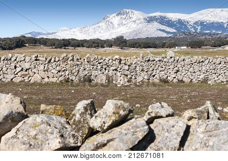 Views of Guadarrama Mountains In Madrid Province Spain. It can be seen La Maliciosa Peak and Bola del Mundo Peak.
