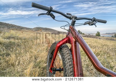 Fort Collins, CO, USA - November 3, 2017: Salsa Mukluk Carbon GX1 Fat Bike (2017) on a single track trail in Lory State Park, fall scenery.