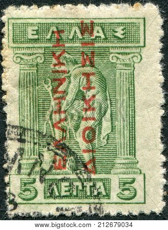 GREECE - CIRCA 1911: Postage stamps printed in Greece, shows Hermes Donning Sandals (overprint, 1913 for the occupied territories of Turkey), circa 1911