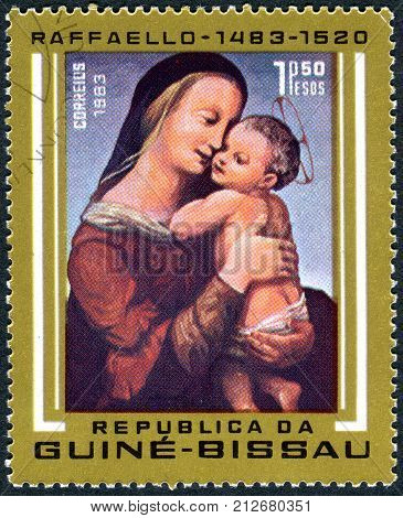 GUINEA - BISSAU - CIRCA 1983: A stamp printed in Guinea-Bissau shows a painting Tempi Madonna by Raphael a collection of Alte Pinakothek in Munich circa 1983