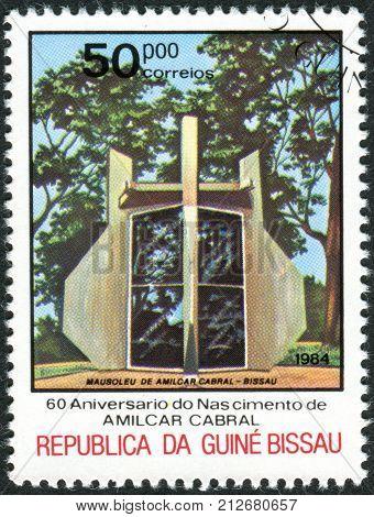 GUINEA - BISSAU - CIRCA 1984: A stamp printed in Guinea-Bissau dedicated to 60th Anniversary of Birth Amilcar Cabral shows the Amilcar Cabral mausoleum Bissau circa 1984