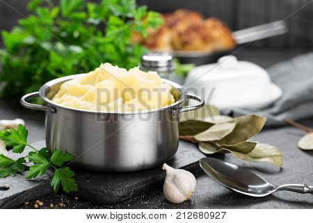 Mashed potatoes in pot on table closeup