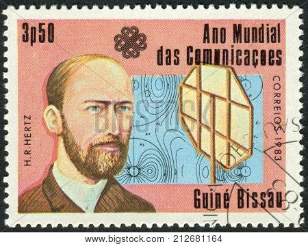 GUINEA - BISSAU - CIRCA 1983: A stamp printed in Guinea-Bissau dedicated to the World Communications Year shows a German physicist Heinrich Hertz circa 1983