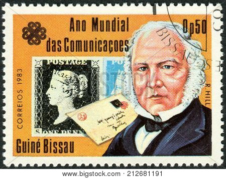 GUINEA - BISSAU - CIRCA 1983: A stamp printed in Guinea-Bissau dedicated to the World Communications Year shows an English teacher inventor and social reformer Sir Rowland Hill circa 1983