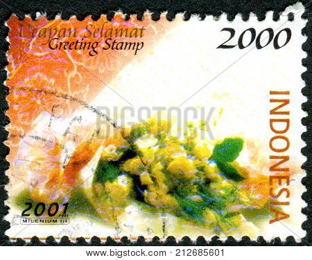 INDONESIA - CIRCA 2001: Postage stamp printed in Indonesia shows a greeting bouquets of flowers circa 2001