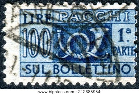 ITALY - CIRCA 1956: Parcel post stamp printed in Italy shows the traditional post horn and face value circa 1956
