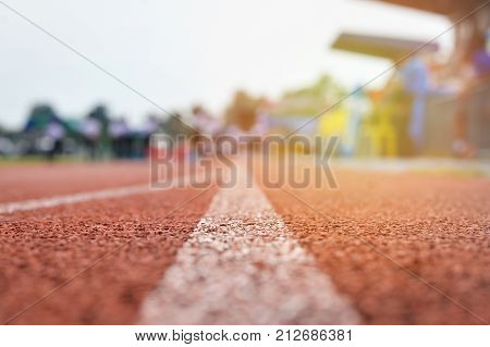 Running track or Racetrack with blurred Background selective focus vintage style for product or business background.