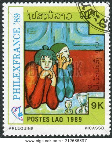 LAOS - CIRCA 1989: Postage stamp printed in Laos dedicated to the Philexfrance 89 international stamp exibition Paris shows Harlequins by Pablo Picasso circa 1989