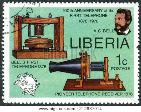 LIBERIA - CIRCA 1976: Postage stamp printed in Liberia is devoted to Cent. of 1st telephone call by Alexander Graham Bell shows AG Bell Telephone and Receiver UPU Emblem circa 1976