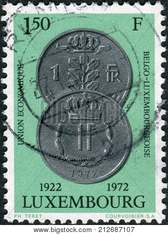 LUXEMBOURG - CIRCA 1971: A stamp printed in Luxembourg is dedicated to the 50th Anniversary of Economic Union of Luxembourg and Belgium shows Coins of Luxembourg and Belgium circa 1971