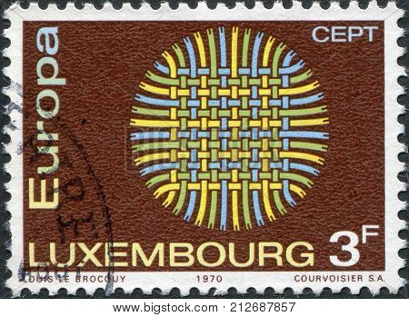 LUXEMBOURG - CIRCA 1970: A stamp printed in Luxembourg shows Interwoven Threads circa 1970