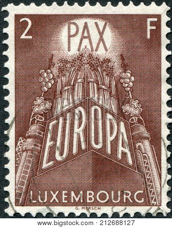 LUXEMBOURG - CIRCA 1957: A stamp printed in Luxembourg the symbol of a united Europe circa 1957