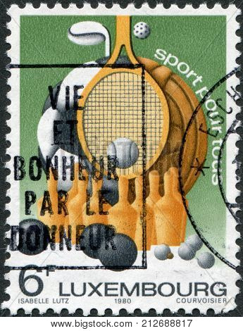 LUXEMBOURG - CIRCA 1980: A stamp printed in Luxembourg represented sports equipment and the slogan