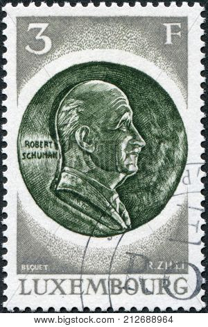 LUXEMBOURG - CIRCA 1972: A stamp printed in Luxembourg is dedicated to 20th anniversary of the Establishment in Luxembourg of the European Coal and Steel Community shows Robert Schuman Medal circa 1972