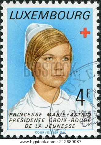 LUXEMBOURG - CIRCA 1974: A stamp printed in Luxembourg shows Princess Marie-Astrid president of the Luxembourg Red Cross Youth Section circa 1974