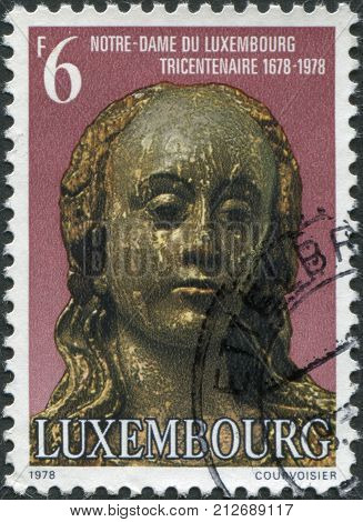 LUXEMBOURG - CIRCA 1978: A stamp printed in Luxembourg shows Our Lady of Luxembourg in Notre-Dame Cathedral circa 1978