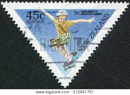 NEW ZEALAND - CIRCA 1995: A stamp printed in New Zealand shows a child riding a skateboard circa 1995