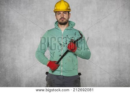 Worker Holding A Crowbar In His Hand, Confident Attitude