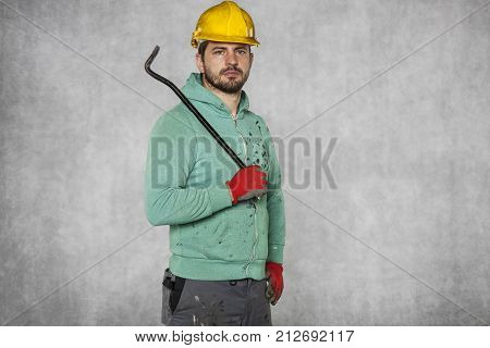 Worker Holding A Crowbar In His Hand
