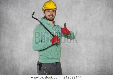 Worker Holding A Crowbar In His Hand, Thumb Up