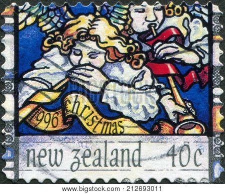 NEW ZEALAND - CIRCA 1996: A stamp printed in New Zealand dedicated to the Christmas shows Heavenly host praising God circa 1996