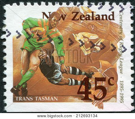 NEW ZEALAND - CIRCA 1995: A stamp printed in New Zealand is dedicated to the 100th anniversary of Rugby League shows a game between the Australia - New Zealand (Trans Tasman) circa 1995