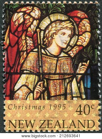NEW ZEALAND - CIRCA 1995: A stamp printed in New Zealand is dedicated to Christmas Stained glass windows depicts Archangel Gabriel circa 1995