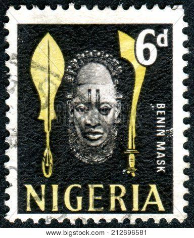 NIGERIA - CIRCA 1961: Postage stamp printed in the Nigeria depicted Benin Pendant Mask circa 1961