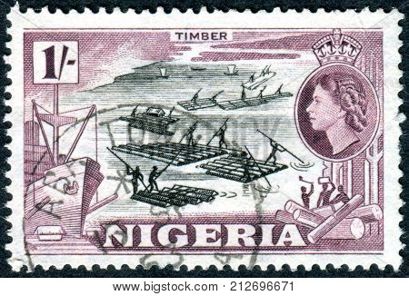 NIGERIA - CIRCA 1953: A stamp printed in Nigeria shows a logging circa 1953