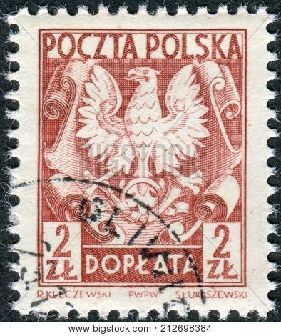 POLAND - CIRCA 1953: Postage stamp (dues) printed in Poland shows the coat of arms of on shield circa 1953
