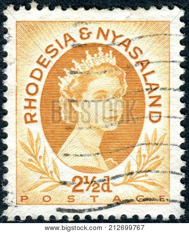 RHODESIA AND NYASALAND - CIRCA 1956: A stamp printed in Federation of Rhodesia and Nyasaland shows a portrait of Queen Elizabeth II circa 1956