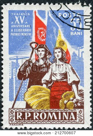 ROMANIA - CIRCA 1959: Postage stamp printed in Romania dedicated to the 15th anniversary of Romania's liberation from the Germans shows Steel Worker and Farm Woman circa 1959