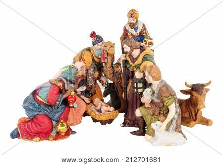 Traditional Christmas nativity scene with Mary and Joseph and baby Jesus isolated on a white background
