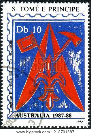 SAO TOME AND PRINCIPE - CIRCA 1988: A stamp printed in Sao Tome and Principe dedicated to International Boy Scouts Jamboree shows the Scout emblem tent flaps axe circa 1988