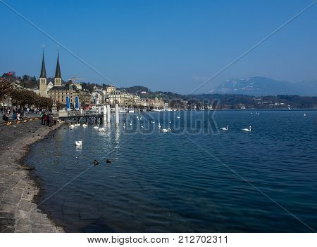 SWITZERLAND LUCERNE - MARCH 19 2015: Sunny day at Lake Lucerne in Switzerland