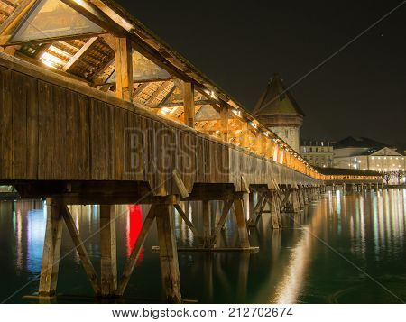 SWITZERLAND LUCERNE - MARCH 19 2015: Night shot the of Chapel Bridge in City of Lucern Switzerland