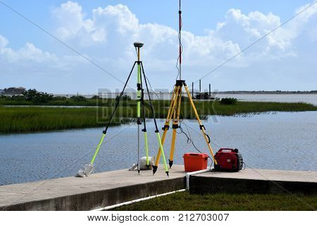 Surveying equipment by the rriver's edge at St. Augustine, Florida.