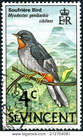 SAINT VINCENT AND THE GRENADINES - CIRCA 1977: Postage stamp Saint Vincent and the Grenadines shows a bird the Rufous-throated Solitaire (Myadestes genibarbis) circa 1977