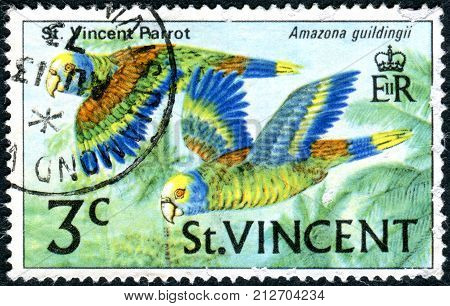 SAINT VINCENT AND THE GRENADINES - CIRCA 1970: Postage stamp Saint Vincent and the Grenadines shows a bird the Saint Vincent Amazon (Amazona guildingii) circa 1970