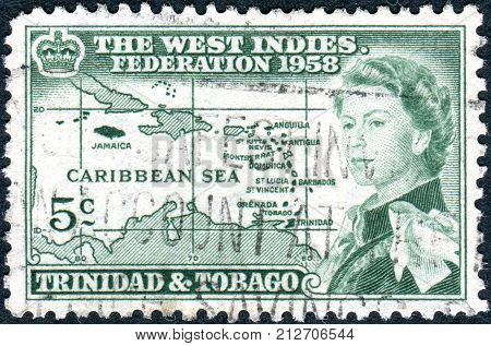 TRINIDAD AND TOBAGO - CIRCA 1958: A postage stamp printed in Trinidad and Tobago is dedicated to the formation of the West Indian Federation shows Queen Elizabeth II on the background of the Caribbean island circa 1958